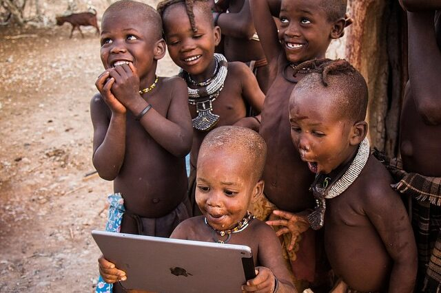 Priceless reaction from tribal children discovering the online world through a tablet screen