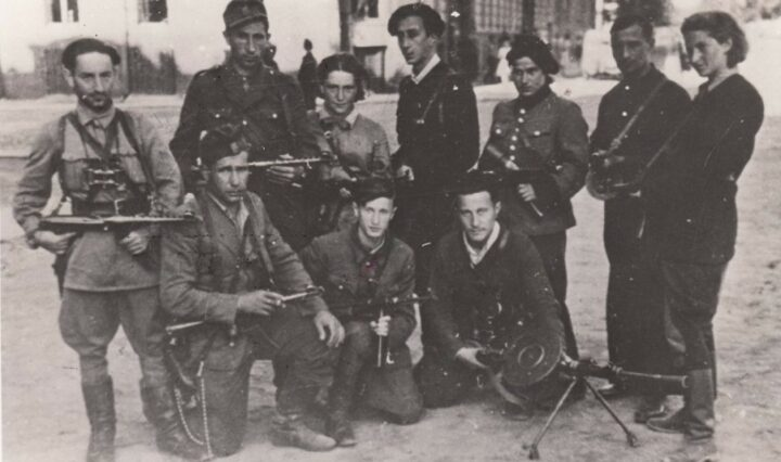 Ten members of The Avengers, eight men and two women, posing while in Vilnius, Lithuania.